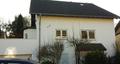 Ansicht mit Dachterrasse (links)